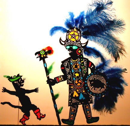 Puss meets a Mardi Gras Indian, from 'Puss in Boots' by Oregon Shadow Theatre, shadow puppets by Deb Chase